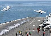 US Navy 070802-N-9988F-002 An F-A-18E Super Hornet and a F-A-18C Hornet launch off the flight deck of the Nimitz-class aircraft carrier USS Dwight D. Eisenhower (CVN 69) during flight operations