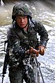 US Navy 070927-N-4267W-284 Steelworker 3rd Class Doug Horox, with Naval Mobile Construction Battalion (NMCB) 7, low crawls through a stream during a jungle warfare training evolution hosted by Marines with the Jungle Warfare Tr.jpg