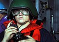 US Navy 080609-N-9604C-083 Boatswain's Mate Seaman Aaron Turner uses sound-powered phones to communicate information regarding fuel consumption.jpg