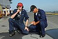 US Navy 080617-N-9774H-008 Damage Controlman 3rd Class Joseph Martin and Damage Controlman Fireman Brayand Osorio participate in the sound-powered phone event during the Damage Control Marathon portion of Surface Line Week 2008.jpg