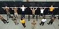 US Navy 080710-N-2959L-281 ailors perform pull-ups while taking a physical screening test at Naval Amphibious Base, Coronado.jpg