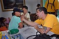 US Navy 080820-N-9958G-080 Chief Legalman (Sel.) Shahar Bikszer arm wrestles with a child at the Hee-Rak-Won Children's Welfare Facility.jpg