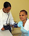 US Navy 081016-N-5642P-054 A Dominican Republic Navy doctor takes the blood pressure of a patient at the 27 Febrero medical site during the humanitarian assistance mission Continuing Promise 2008.jpg