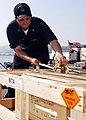 US Navy 090416-N-5215E-038 Aviation Ordnanceman 3rd Class Gregory Castelin prepares an ammunition pallet for crane pickup during an ammunition offload from the amphibious assault ship USS Essex (LHD 2).jpg