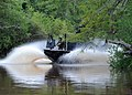 US Navy 090816-N-4205W-017 Special warfare combatant-craft crewmen (SWCC) from Special Boat Team (SBT) 22 operate a special operations craft-riverine during the filming of a scene in a upcoming major motion picture.jpg