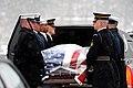 US Navy 100216-M-9054G-158 A Joint Service Honor Guard unloads the casket of Congressman John P. Murtha.jpg