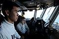 US Navy 110211-N-4590G-052 Aviation Boatswain's Mate (Handling) 3rd Class Tanan Tangpradabkul, from Bangkok, Thailand, stands watch.jpg