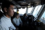 US Navy 110211-N-4590G-052 Aviation Boatswain's Mate (Handling) 3rd Class Tanan Tangpradabkul, from Bangkok, Thailand, stands watch.jpg