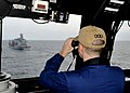 US Navy 110315-N-2147L-004 Officer of the Deck Lt. j.g. Timothy Gorman observes the Military Sealift Command fleet replenishment oiler USNS John Le.jpg