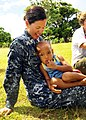 US Navy 110415-N-BC134-092 Senior Chief Hospital Corpsman Anna Wood relaxes after a medical civil assistance program operation in support of Pacifi.jpg