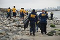 US Navy 110421-N-XC874-070 Sailors assigned to Naval Base Point Loma participate in a shoreline cleanup.jpg