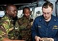 US Navy 110725-N-OV802-018 Lt. j.g. Brian Senko instructs Tanzanian navy Capt. A.M. Kihula and Lance Cpl. S.K. Rutungu on the bridge of USS Samuel.jpg