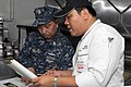 US Navy 110809-N-JV466-017 Thai executive pastry chef Pongpisit Ungsuchaikij goes over a Thai recipe with Chief Culinary Specialist Mario Parocha,.jpg