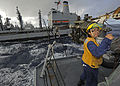 US Navy 111101-N-VH839-061 Boatswain's Mate 3rd Class Candace Worthan mans the underway replenishment fueling station aboard the Arleigh Burke-clas.jpg