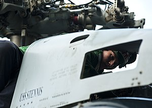 US Navy 111229-N-BT887-540 Aviation Structural Mechanic 3rd Class Philip Alexander performs maintenance on an MH-60R Sea Hawk helicopter from the R.jpg