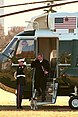 US President George W Bush saluted exiting Marien One.jpg