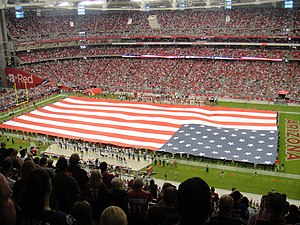 English: The stars and stripes unfurled during...