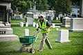 Volunteers work during the National Association of Landscape Professionals' 19th annual Renewal and Remembrance at Arlington National Cemetery (19857610272).jpg