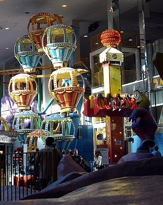 Galaxyland - Balloon Race.  Also visible are a statue of Cosmo (in the foreground), a small portion of the Autosled (near the three highest balloons) and Cosmic Bounce (to the right of Balloon Race)