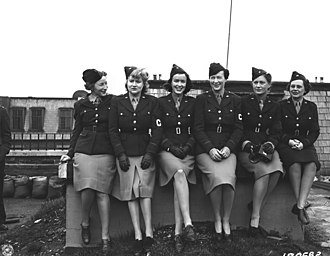 Lee Miller - Miller with other women war correspondents who covered the U.S. Army in the European Theater during World War II in 1943. From left to right: Mary Welch, Dixie Tighe, Kathleen Harriman, Helen Kirkpatrick, Lee Miller, and Tania Long.