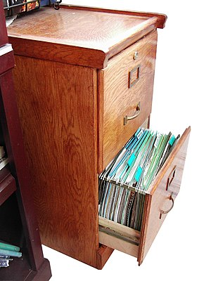 Filing cabinet - A wooden Filing Cabinet with drawer open