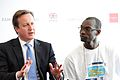 Youth worker Kokou Djagadou listens to David Cameron at the London Summit on Family Planning (7561091876).jpg