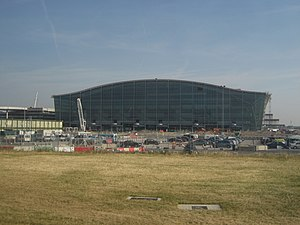 Heathrow Terminal 5 - Terminal 5 under construction in July 2006. The frontal car park building can be seen to the left, air side is to the right