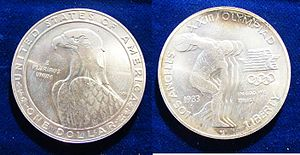 John Mercanti - $1 Silver Coin 1983 P commemorating the Los Angeles Olympics 1984. Medallists were the Chief Engraver of the US Mint, Elizabeth Jones and John M. Mercanti