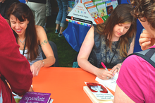 Johnson, at right, along with fellow author Lauren Myracle at left while signing at the LA Times Festival of Books in 2012.