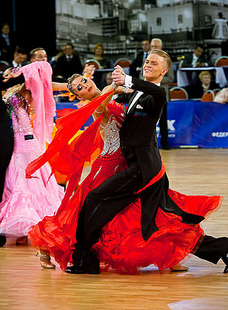 Dance partnering - A dancer guides his partner via physical connection, a commonly used technique in partner dances