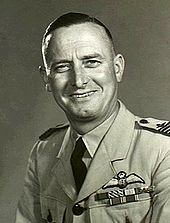 Head-and-shoulders portrait of man in military uniform with pilot's wings on left breast pocket