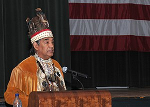"Meherrin - Chief Thomas ""Two Feathers"" Lewis of the Meherrin Tribe speaks at a United States Navy function in Norfolk, Virginia in 2008"