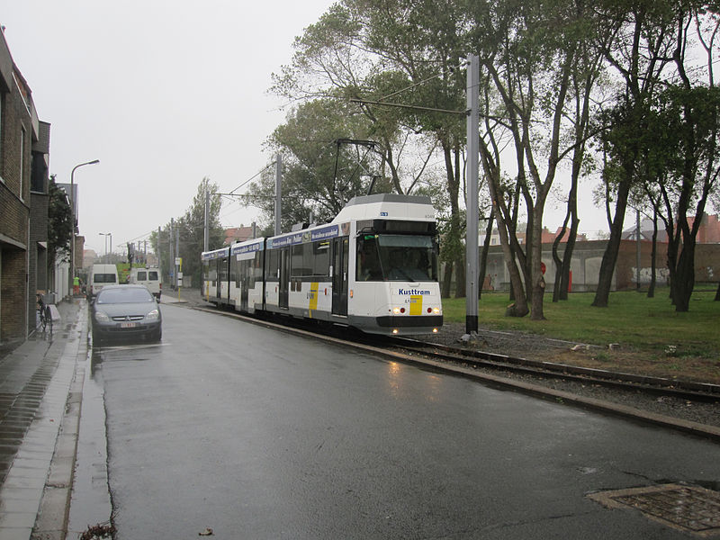 On a rather wet morning on 12 October 2011, De Lijn tram no. 6049 pauses prior to its next working along the Belgian coast to De Panne. The tramway connects here with SNCB/NMBS before passing through Zeebrugge, Blankenberge, Oostende and Nieuwpoort. Most of the Belgian coast is built up and well developed for the tourist trade.