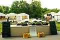 15. Boulefestival im Georgengarten 19. Mai 2012 Grand Prix Hannover Triplette Gewinnertisch und Zelte La Provence.jpg