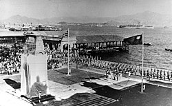 The liberation of Hong Kong in 1945 was celebrated at the Cenotaph in Victoria with the raising of the Union Flag and the Flag of the Republic of China.