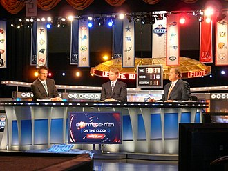 Jon Gruden - Gruden (center) at the 2011 NFL Draft with ESPN
