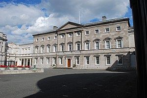 Post and lintel - Leinster House in Dublin retains columns under a pediment for aesthetic reasons; the similar façade at the White House at least holds up a porch