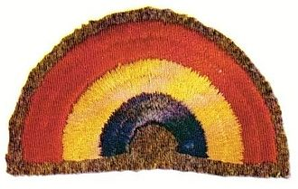 "42nd Infantry Division (United States) - Original design of 42nd Infantry Division ""Rainbow"" patch, showing half arc. The patch was later modified to a quarter arc."
