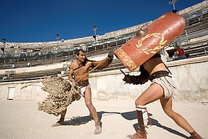 re-enactment of a gladiator fight in the arena...