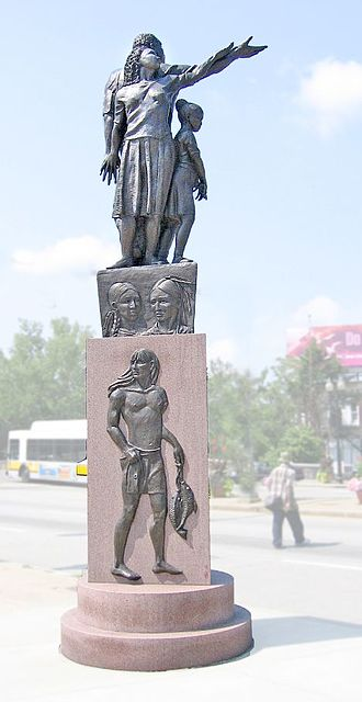 """Mattapan - """"Rise,"""" a pair of statues installed in 2005, flank Blue Hill Avenue in Mattapan and define it as a gateway to Boston. This statue is by Fern Cunningham."""