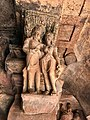 6th century amorous couple on pillar top looking below in Cave 3, Badami Hindu cave temple Karnataka 8.jpg