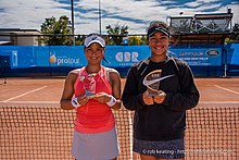 Photo of Risa Ozaki and Destanee Aiava with their ACT Clay Court International #1 trophies