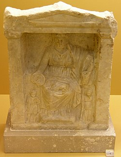 Athenian Cybele seated on her throne with a tymbalon, (4th century BC, Athens)