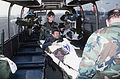 A Bosnian soldier is lifted off a medical transport bus by two airman and will be loaded on to a waiting C-141 to go to the United States F-3203-SPT-95-000010-XX-005.jpg