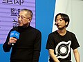 A Certain Magical Virtual-On producers on Sega booth stage 20180127d.jpg