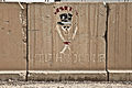 "A T-wall painted with a ""Witchdoctor"" sign is seen at Camp Liberty, Iraq, July 7, 2011 110707-A-HR697-076.jpg"
