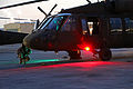 A U.S. Army UH-60 Black Hawk helicopter crew member assigned to the Puerto Rico Army National Guard inspects the aircraft prior to conducting night flight training at the aviation support facility in Isla 140902-Z-KD550-741.jpg