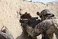 A U.S. Special Forces Soldier with Combined Joint Special Operations Task Force-Afghanistan returns fire toward an identified enemy fighting position during the clearance of Bahlozi, Maiwand district, Kandahar 140101-A-LW390-309.jpg