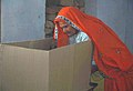 A old lady casting her vote at a polling booth of Village Jakarana, in Alwar Rajasthan, during the 4th Phase of General Election-2009 on May 07, 2009.jpg