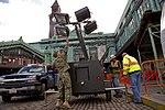 A sailor from Coastal Riverine Squadron 4 helps to erect a ten-kilowatt light plant at the Hoboken Transit Terminal in Hoboken, N.J., on Nov 121104-N-QP268-005.jpg